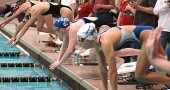 Senior swimmer Elizabeth Malone took off from the starting block en route to a new school record in the 50-yard freestyle at the Wayne Invitational at Wright State University last weekend. Malone finished second in the event in 25.87 seconds. (Photo by Megan Bachman)