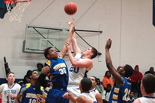 Cole Edwards leaped just above a Jefferson defender's reach to score a basket during the Yellow Springs High School boys varsity team's loss last weekend. Earlier in the week, junior Roland Newsome scored 46 points in the team's 93–89 overtime loss to Middletown Christian. (Photo by Megan Bachman)