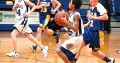 Guard Christian Johnson took a rebound down court before passing off to his teammate Hayden Orme on the seventh-grade boys basketball team. Johnson led scoring with four points during the team's 44–10 loss to Xenia Christian last week. Visit www.ysnews.com for more photos from the game. (Photo by Megan Bachman)