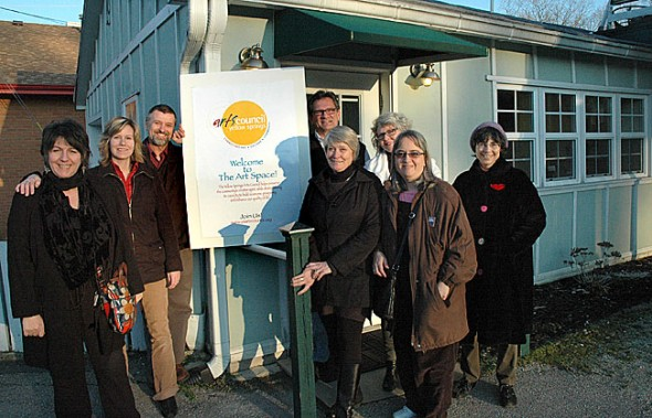 Village Arts Council is moving from Oten Gallery to a new gallery and performance space at 111 Corry Street, the building formerly occupied by Dolbeer's Cleaners and the Rolling Pen Book Cafe. Arts Council board and staff members pictured are, from left, Corrine Bayraktaroglu, Deb Housh, Jerome Borchers, Nick Gaskins, Kathy Reed, Anita Brown, Joanne Caputo and Nancy Mellon. (Photo by Lauren Heaton)