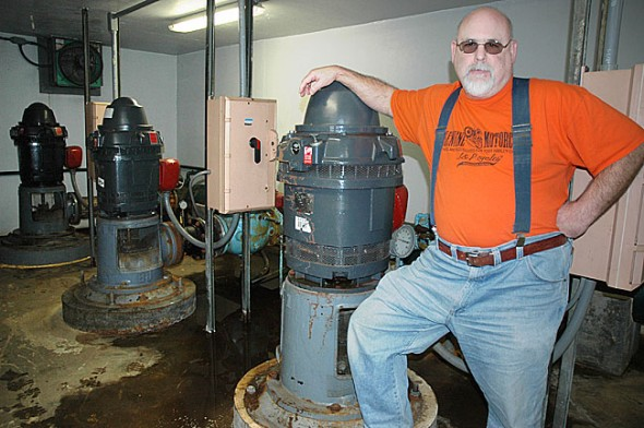 Ted Dunevant, operator of the Yellow Springs water plant for the past 26 years, is retiring at the end of this month. He's shown in the water plant's pump house, the last stop for local water before it's pumped into the village. (Photo by Diane Chiddister)