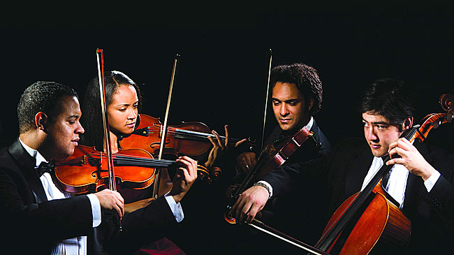 The Harlem Quartet will play twice in Yellow Springs this weekend. On Saturday, March 17, the group plays at 7:30 p.m. at the Herndon Gallery on the Antioch College campus. Included in their performance will be an original composition by Yellow Springs native Allen McCullough. On Sunday, March 18, the quartet plays at 7:30 p.m. at the First Presbyterian Church as part of the Chamber Music Yellow Springs series. (Submitted photo)