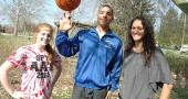 Yellow Springs High School athletes, from left, Elizabeth Malone, Antone Truss and Maryah Martin won awards for the winter sports season. Swimmer Malone and girls basketball player Martin were selected as this year's Bulldog award-winners, while Truss was given sportsmanship and coach's awards for the boys basketball squad. (Photo by Megan Bachman)