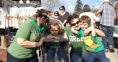 "Christa Thomas, left, and Jen Foley celebrated the local St. Patrick's Day festivities with their children, Aeridan and Oriah. The Yellow Springs Chamber of Commerce organized the ""Shamrocks & Shenanigans"" pub crawl, which drew swarms of visitors to the village on a sunny Saturday."