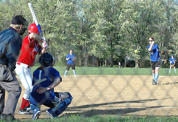 Senior Leanne Holmes pitched the Yellow Springs High School softball team's first game in three years, which was suspended due to darkness with visiting Belmont up 19–16. Covering the plate was catcher Chelsea Horton, a freshman who went 3–3 with three runs scored on the night. (Photo by Megan Bachman)
