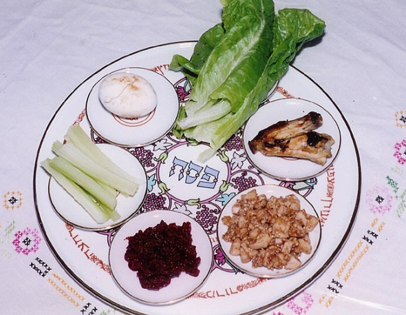 A Passover Seder Plate showing (clockwise, from top): Maror and chazeret — Bitter herbs, symbolizing the bitterness of slavery  which the Hebrews endured in Egypt; Z'roa - A roasted lamb or goat shankbone, symbolising the Passover  sacrifice; vegetarians often substitute a beet; Charoset — Apple, nut and honey paste representing the mortar used by the Jewish slaves to build the storehouses; Karpas — A vegetable which is dipped into salt water representing tears shed by Hebrew slaves; Beitzah — A hard-boiled egg, symbolizing the festival sacrifice and roasted and eaten as part of the Seder meal. Some Seder plates also include an orange to represent those considered out of place in more conservative Jewish teachings. (Photo from Wikipedia)