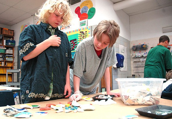 Fifth grade Mills Lawn students Will Mitdbo and Stephen Kaiser-Parlette worked on a joint mosaic project last week, which will soon become part of the newly tiled Mills Lawn School sign at the front entrance of the school. (Photo by Lauren Heaton)