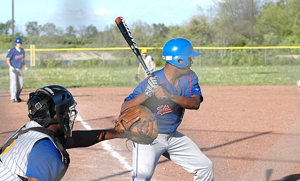 YSHS batter Eric Lawthorn prepared to knock in an RBI during Bulldogs' 7–5 loss to Ponitz Career Center on Monday. Austin Pence, on third base, scored on the ensuing play, an in-field single. (Photo by Megan Bachman)