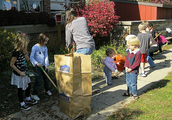 Some participants at last fall's clean-up event. Mulch spreading will take place this Saturday, April 21, from 10 a.m. to 2 p.m. (Submitted photo)