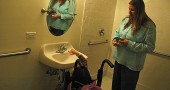 Mia Campbell and her mother, Carrie, test out the sink in the handicapped-accessible bathroom. (Photo by Megan Bachman)