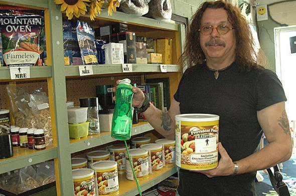 Springs Survival Store owner Stan Hiner explains the unbeatable utility of dehydrated vegetable protein and a self-filtering water bottle in the event of an emergency. Both can be purchased at the new business, located behind Kings Yard in the former tie dye shop space. (Photo by Lauren Heaton)