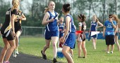 Nicole Worsham finished her leg of the 4x800-meter relay race before passing the baton to fellow YSHS runner Rikako Kida at last week's Bulldog Invitational. The relay team, which also included Lois Miller and Alex Brown, won the event in 10:49.91, nearly 10 seconds ahead of higher-ranked opponents, Shawnee Springfield. (Photo by Megan Bachman)