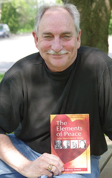 Fred Arment and his new book The Elements of Peace (Photo by Sehvilla Mann)