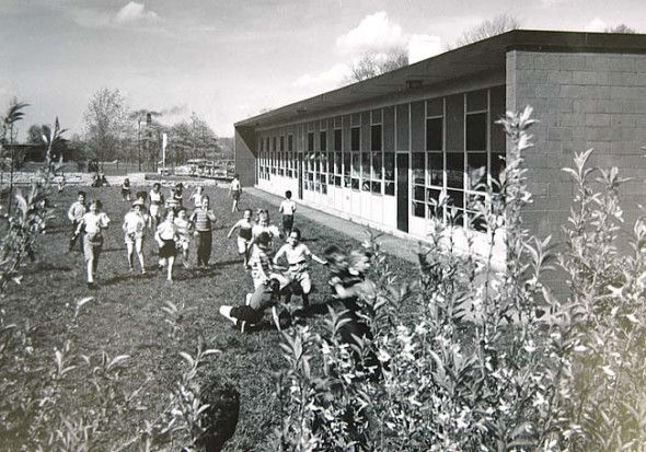 Students were ecstatic to be out on the golf course side of the the new Antioch School around when it was built in 1953. The school will celebrate its 90th anniversary with an open house reunion on Saturday, July 7, noon–4 p.m. at the school. (Photo courtesy of Antiochiana, Antioch College)
