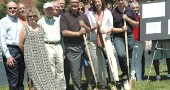 At last Friday's groundbreaking ceremony for the first phase of construction of the Center for Business and Education were, front row from left: Glenn Watts, former board member of Community Resources, or CR, developer of the project; Village Council member Karen Wintrow; CR founding member Sam Bachtell; CR board member Karl Zalar; Village Manager Laura Curliss; and Brad Beam of A&B Asphalt Corporation. In the second row from left are: Council member Rick Walkey; Jerry Gasho; Jarad Barnett of Mills Development, CR's marketing partner; Carol Gasho, past CR board member; David Kell of the Greene County Department of Development; Village Assistant Planner Ed Amrhein; Village Economic Sustainability Coordinator Sarah Wildman; and Council member Gerry Simms.