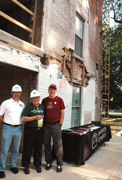 Last Saturday morning Karl McCartney of Thomas & Marker Construction, left, and Antioch College Vice President for Advancement Steve Sturman, right, led alumni, including Ron Winger, '64, of San Diego, on tours of the ongoing renovation of North Hall. The dormitory, constructed in 1852, is being renovated to achieve the LEEDS gold certification for environmental responsibility, and when completed, will be the oldest building in the country with that distinction. (Photo by Diane Chiddister)
