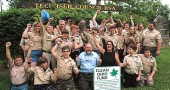 Boy Scouts at Camp Birch cheered at the news that Clean Ohio finally received funding for its open space and agricultural easement purchase programs. Last year Camp Birch used more than $600,000 from the statewide program to permanently protect the farms and wetlands at the 400-acre, 80-year-old camp. Pictured is Springfield Troupe #311, along with, front center, Don Hollister of Environment Ohio and Krista Magaw of Tecumseh Land Trust.