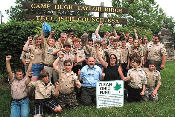 Boy Scouts at Camp Birch cheered at the news that Clean Ohio finally received funding for its open space and agricultural easement purchase programs. Last year Camp Birch used more than $600,000 from the statewide program to permanently protect the farms and wetlands at the 400-acre, 80-year-old camp. Pictured is Springfield Troop #311, along with, front center, Don Hollister of Ohio League of Conservation Voters and Krista Magaw of Tecumseh Land Trust.