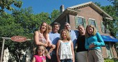 New owners gathered at the property with their families. Back row, from left are Molly Kibbelwhite, Gabriella Kibbelwhite, Lee Kibbelwhite, Brendan Comerford, Kristy Lewis and Cecilia Comerford; front row, Lily Kibbelwhite, Ella Comerford. (Photo by Megan Bachman)