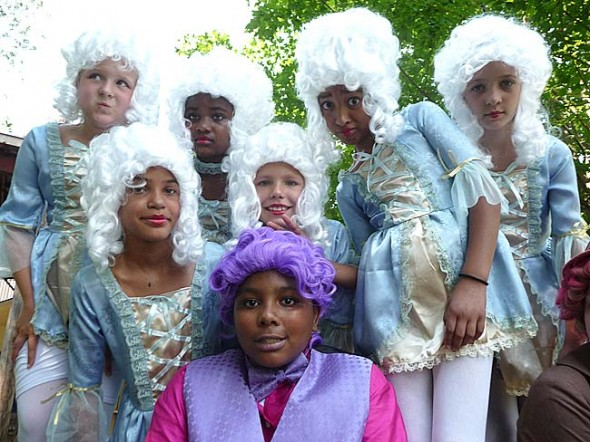 This year's Yellow Springs Kids Playhouse show mashes up a Mozart opera with a Marx brother film. Mo's Night at the Opera runs from Thursday, July 12, to Sunday, July 15, and from July 19–22 at the Antioch College Amphitheatre, 759 Corry St., starting at 7:30 p.m. Some cast members are, clockwise from bottom front: Kevon Matthews, Taylor Felder, McKenzie Byers, London Neal, Tahlia Potter, Sumayah Chappelle and Samantha Woolley. (Submitted Photo by John Fleming)
