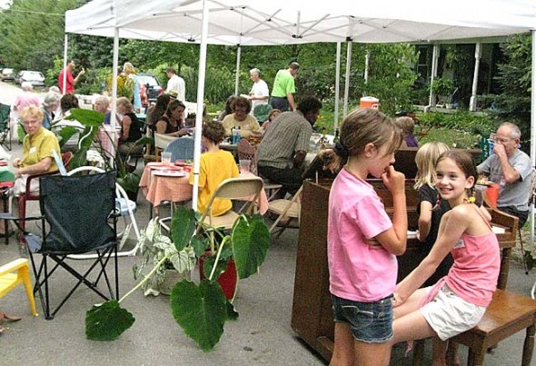 Last year's Davis/Whiteman/Phillips street block party resembled a cafe, with tables covered with tablecloths and fresh flowers. The Human Relations Commission urges villagers to organize a partiy for their neighborhood on either Saturday, Aug. 18, or Sunday, Aug. 19.