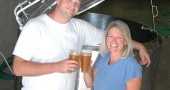 Local beer-lovers Nate Cornett and Lisa Wolters toasted to their new business venture, Yellow Springs Brewery, which is set to begin brewing and serving craft beer at its MillWorks location by year's end. (Photo by Megan Bachman)