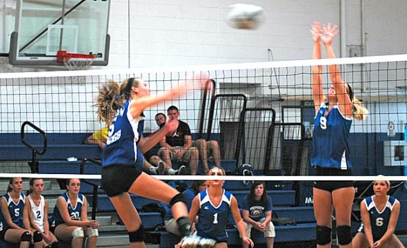 Senior Emma Peifer slammed an ace at the Greenon side during the Yellow Springs High School girls varsity volleyball team's 25–18, 25–18 stomping of the visitors. The Lady Bulldogs started their season 3–0. (photo by Megan Bachman)