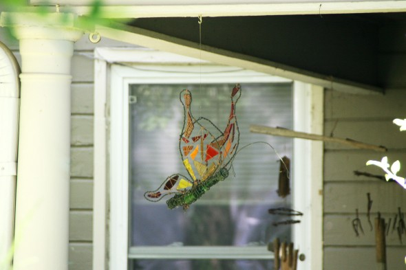 A rainbow butterfly made of scrap colored glass hanging from a porch on Limestone St. (photos by Suzanne Ehalt)