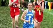 Yellow Springs High School cross-country team runner Christina Brewer charged down a hill during the Fairborn Invitational last week. Brewer finished in 54th place in 26:56, securing a third-place finish for her team. Teammate Lois Miller won the race with a meet record time of 20:56. (Submitted Photo)