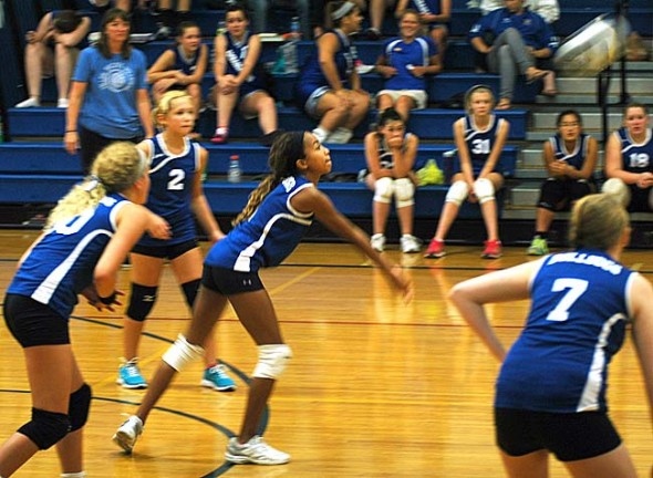 Julian Roberts took a dig for the McKinney eighth-grade girls volleyball team at its quad meet on Saturday. During the win against Troy Christian, Roberts had eight points, seven assists, four kills and three aces. (Photo by Megan Bachman)