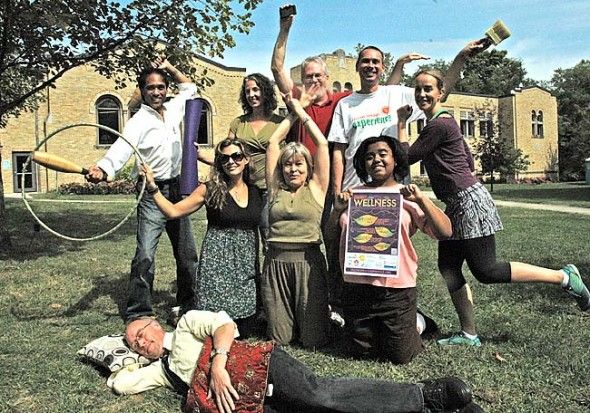 Holistic health practitioners, artists and organizers of this weekend's Wellness Experience  are, in front, Stacy Arnett of Design Sleep; second row, from left, Alice Young-Basora of Nina Carina Jewelry, Reena Appell of Yoga Springs, and reiki practitioner Aiysah Walker; third row, traditional healer Virgil Mayor Apostol, event organizer Monica Hasek, Steve Deal of IFG Health, Brian Housh of the Arts Council, and Molly Lunde of Yoga Springs. A Wellness fair runs from 10 a.m. to 4 p.m. on Saturday at the John Bryan Center, followed by in-depth wellness workshops on Sunday. (photo by Megan Bachman)