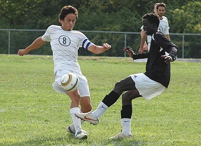 Senior fullback Levi Perry won a challenge against a Fairborn opponent at the Yellow Springs High School boys varsity soccer game on Saturday. Perry scored two goals during the Bulldogs' decisive 3–1 victory. (Photo by Megan Bachman)