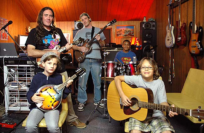 Oliver Simons and Zac Fenton started Lord of the Strings musical instruction in a studio space at MillWorks to teach children and adults how to play instruments alone and with others. Here at a recent music lesson, are, clockwise from front right, Eli Eyrich, Dorian Campbell, Simons, Fenton and Drevin Roberts. (Photo by Megan Bachman)
