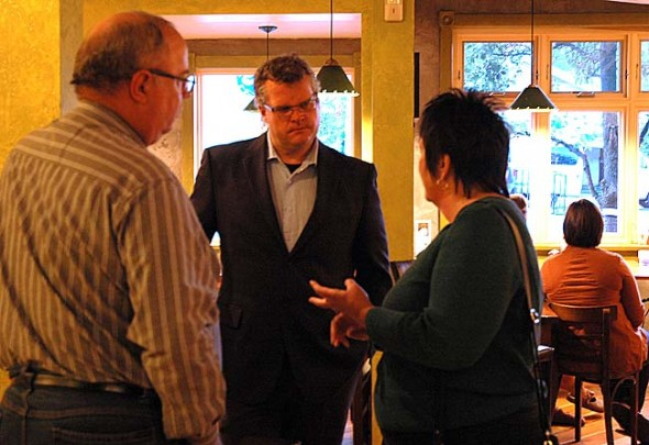 "Yellow Springs resident and Democrat Jeff Robertson challenges incumbent Republican Chris Widener in the District 10 Ohio Senate race. Robertson is throwing a ""pre-victory"" party at the Glen Building on Oct. 19. Pictured is Robertson talking with villagers at The Winds after his book signing. (Photo by Megan Bachman)"