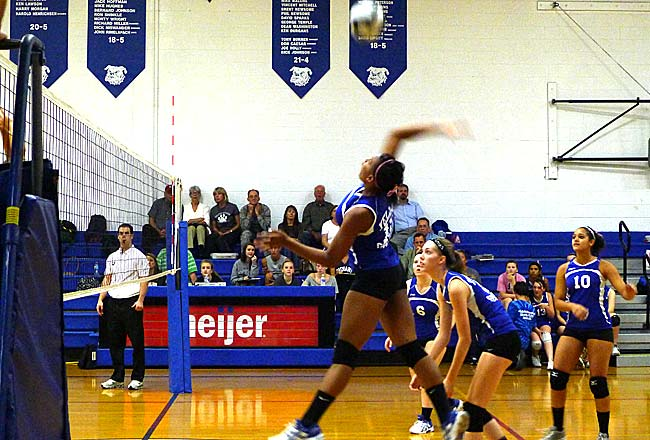 Yellow Springs High School volleyball star Kennedy Harshaw spiked the ball back at Troy Christian at a home match last week. Harshaw led the Bulldogs to a three-set victory with 10 kills and 10 digs on the night. (Photo by Megan Bachman)