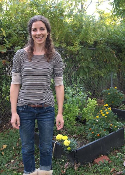 Jillian Slater in her new Yellow Springs back yard garden. (Photo by Nadia Mulhall)