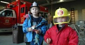 Kian and Neirin Barker learned all about firefighting at an open house for Miami Township Fire-Rescue last week. The Barkers were among the villagers who took a ride in a fire truck, explored the inside of an ambulance and watched a firefighter don the department's heavy gear. (Photo by Megan Bachman)