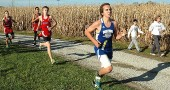 Yellow Springs High School sophomore Connor Gravely-Novello ran through the cornfields at the 26th annual Yellow Springs Invitational held at Young's Jersey Dairy on Tuesday. Gravely-Novellofinished in 18:50, good for16th place. (Photo by Megan Bachman)