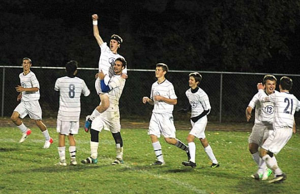 Nathan Miller celebrated his game-winning goal with teammates during the Bulldogs 2–1 come-from-behind victory over visiting Madison in last Thursday's  district opener. Miller scored on a header with less than three minutes left in the game. From left are Grant Reigelsperger, Levi Perry, Miller, Roland Newsome, Fielding Lewis, Gabe Rehm, Ian Chick and Jared Scarfpin. (Photo by Megan Bachman)