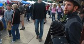 Ben Hemmendinger busks with accordion at 2012 Fall Street Fair (photo by Aaron Zaremsky)