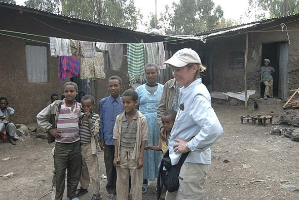 "Documentarian Aileen LeBlanc with Fekadu (obscured) and his family in Gondar, Ethiopia. The film, ""Take Us Home,"" documents the saga of Ethiopian Jews and their quest to emigrate to their spiritual homeland, Israel. The film premieres Nov. 15 at the Dayton Art Institute.  (submitted photo)"