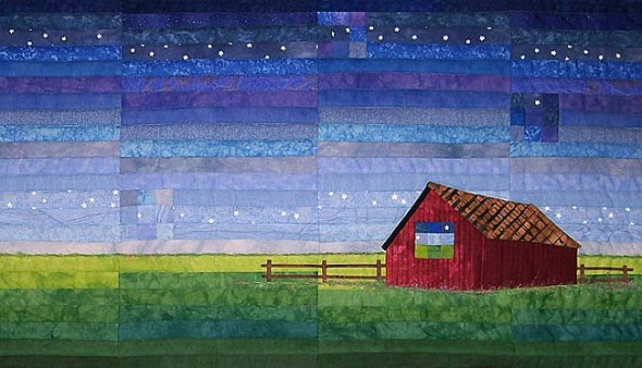 A quilted hanging by Pam Geisel (detail). See more pictures of featured artifacts below.