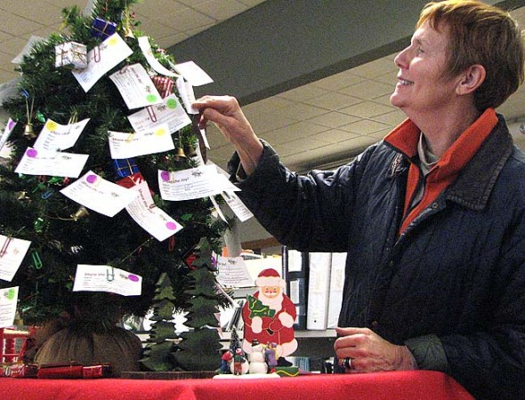 Debbie Henderson is one of the community volunteers who helps to organize Share the Joy, a holiday gift-giving project located at the Yellow Springs Library that provides gifts for needy villagers. See page 4 for details. (Photo by Jeff Simons)