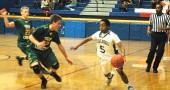 Guard Bryce White made a move on a Troy Christian defender during the YSHS boys basketball team's 67–47 loss at home on Friday. The defeat put somewhat of a damper on a week in which the Bulldogs beat Jefferson at its home court for the first time in YSHS history. (Photo by Megan Bachman)
