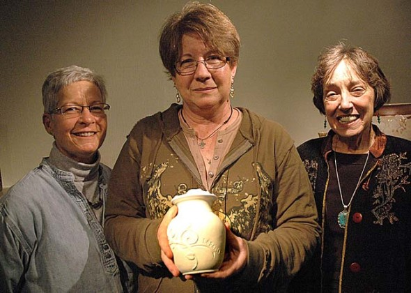 John Bryan Community Pottery members, from left, Carol Culbertson, Lynn Riewerts Carine, and Cindy Butler-Jones, designed and crafted a memorial urn for an Arkansas baby born with a severe birth defect. They worked free-of-charge to honor baby Hope, who lived for just 28 hours after she was born in October. See photos of the finished urn below. (Photo by Megan Bachman)