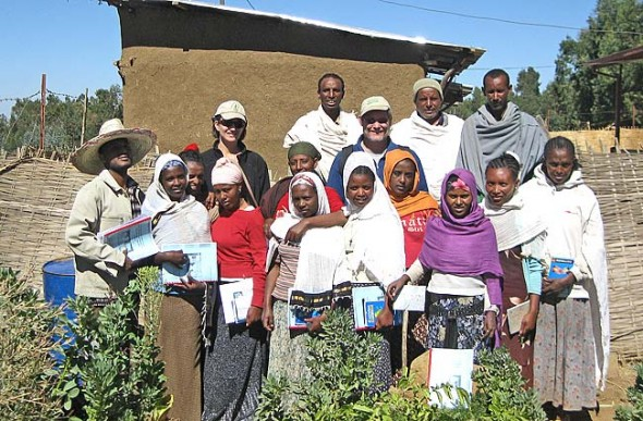 Andy Carlson and Jessica Bilecki stood in a garden they helped grow with a group of villagers in the Kossoye region of Ethiopia in order to improve the village diet. The two Yellow Springs residents are part of the Kossoye Development Project, initiated by Carlson's father Dennis Carlson with the University of Gondar in the 1960s to improve the health and longevity of the region's people. (Submitted photo)