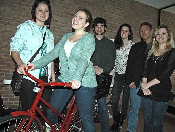Students in Antioch College's global health seminar presented their solutions to campus and community health problems at a public forum last month. One group started a college bicycle co-op and refurbished eight bikes to rent to students free-of-charge. From left are group members Jordan Berley, Emma Gilruth, Lucas Gottke and Katie Pitsenbarger, Antioch facilities manager Reggie Stratton and group member Elaine Bell. (Photo by Megan Bachman)