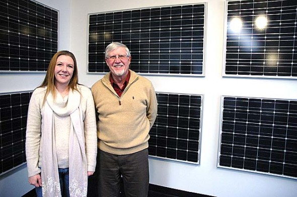 New company GreenTech Energy Solutions will offer home energy audits, complete home retrofits and solar power products to local customers. Shannon Lindstrom, left, and alternative energy expert Chris Meyer, right, are partners in the new firm, along with Scott Lindstrom. (Photo by Megan Bachman)