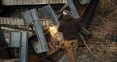 A Greene County road crew member took a blow torch to the steel girders to dismantle the bridge last week.