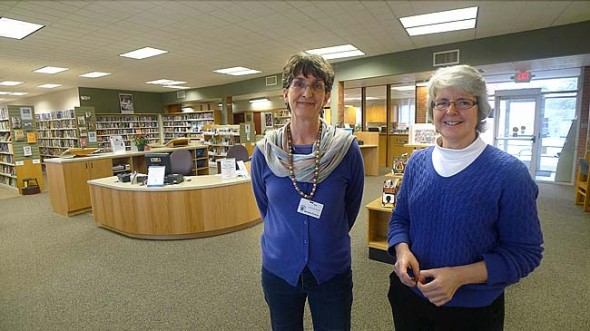 Librarians Ann Cooper, left, and Connie Collett helped design the new layout of the Yellow Springs Community Library, which recently underwent a major renovation. The more spacious lobby area seen behind them will promote better flow, while the new HVAC equipment, windows and doors may keep the 50-year-old building in good shape for another 50 years. (Photo by Megan Bachman)